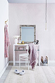 Mirror with silver frame on white dressing table in the bedroom