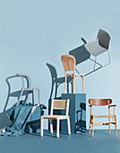 Various chairs in front of a blue-gray wall