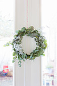 Wreath of eucalyptus branches and gypsophila on door