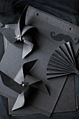 Windmills and fan made from black paper