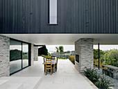 Dining set on roofed terrace of architect-designed house