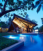 Tropical-style architect-designed house with pool and garden