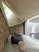 Concrete and stone pool with skylight