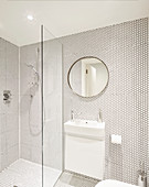White bathroom with honeycomb mosaic tiles