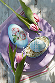 Easter egg decorated with lace ribbon and beads in egg-shaped box