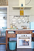 Oven, ceramic hob and extractor hood in country-house kitchen