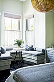 Custom bench with seat cushions in window bay in bedroom