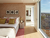 Bedroom with floor-to-ceiling windows and view of London