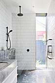 Bright bathroom with shower and garden view