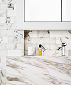 Marble vanity and marble wall tiles in the bathroom