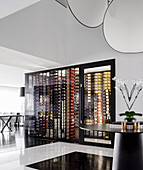 View of designer wine cabinet in open living room