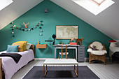 Child's attic bedroom with turquoise wall