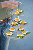 Fried eggs on bread on vintage cake stand