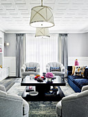 Bright living room with upholstered furniture and a dark coffee table