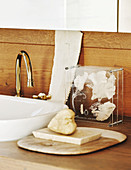Soap dish next to sink on wooden washstand
