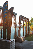 Wooden sculptures and outdoor shower on roof terrace