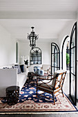 Colonial style living room with open arched doors to the courtyard
