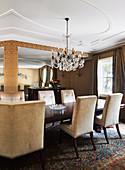 Velvet upholstered chairs in the glamorous dining room