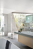 Modern bathroom with glass wall in concrete, architect-designed house