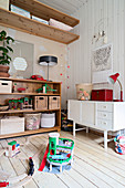 Old sideboard and baskets of toys on shelves