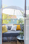 Cushions on couch and parasol on balcony