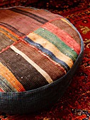 Floor cushion made from pieces of carpet