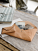Pale leather envelopes used as storage bags