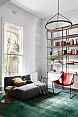 Gray upholstered sofa, leather chair and open shelf in the living room