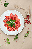 Strawberry carpaccio with pink pepper