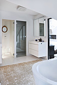 Washstand in ensuite bathroom with glass doors