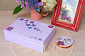 Purple jewellery box decorated with lace motif and pressed flowers