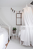 Cot with illuminated canopy in parent's bedroom