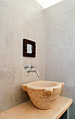 Sink made from large old stone mortar
