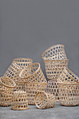 Collection of baskets of various sizes against grey wall