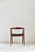 Scandinavian wooden chair against white wall