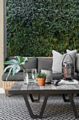 Outdoor living room with green wall