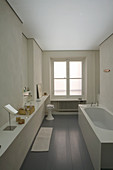 Long narrow bathroom with bathtub in period building