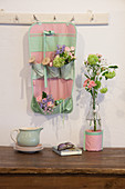 Posies and thread reels in organiser made from mint-green and pink fabric