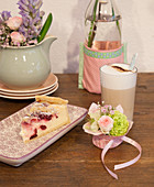 Coffee and cake with vintage-style crockery and flower arrangements