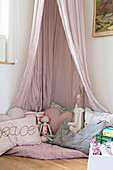 Cosy corner in pink with canopy in girl's bedroom