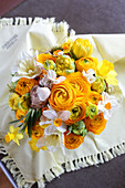 Opulent spring bouquet of ranunculus, tulips and narcissus