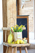 Narcissus in paper bag surrounded by Easter decorations
