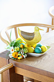 Easter posy, Easter eggs and duck ornament on table