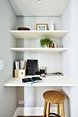 Small workspace with shelves, desk top and wooden stool
