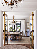 Glance into the dining room with a round table and antique, Gustavian chairs