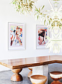 Custom made teak table and stool, modern art on the wall