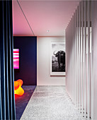 Hallway with terrazzo floor and large-format photography on the wall