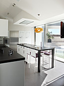 Island counter and glass wall in modern designer kitchen