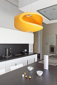 Modern orange designer lamp in kitchen
