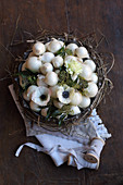 White onions, anemones and ivy berries in wreath